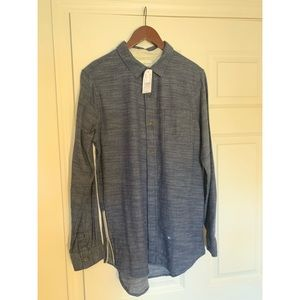 On the byas, button down shirt, blue shirt